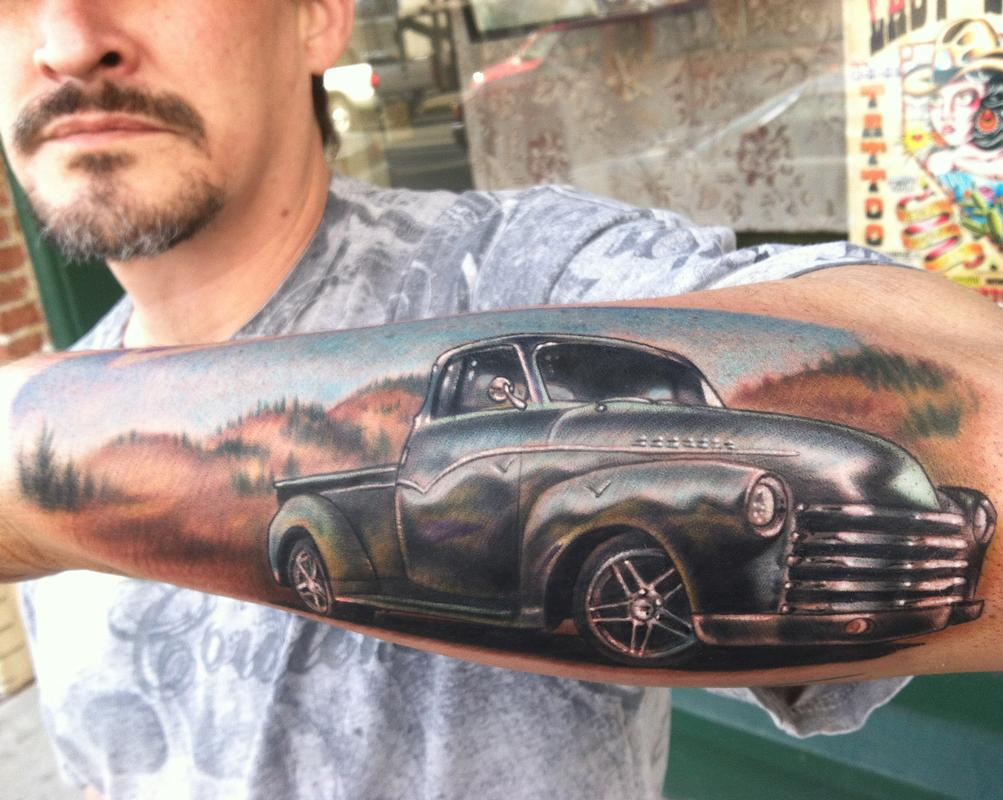 Lovely-Car-Tattoo-On-Arm